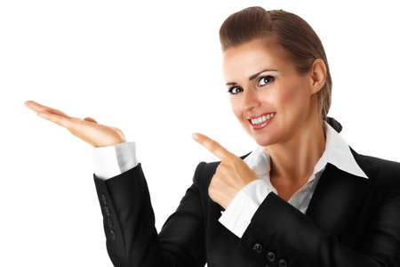 smiling modern business woman pointing finger on empty hand isolated on white Stock Photo