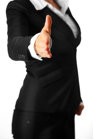 business woman: modern business woman stretches out hand for handshake isolated on white