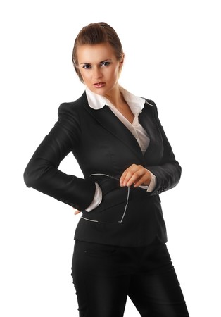 authoritative woman: serious modern business woman with glasses isolated on white