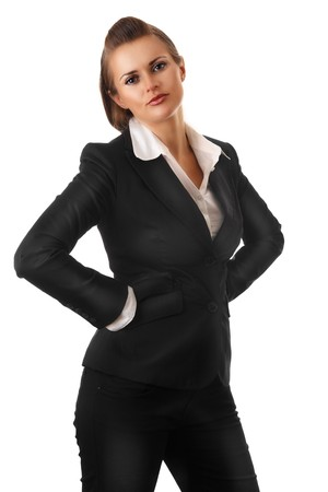 certitude: angry modern business woman with hands on hips isolated on white