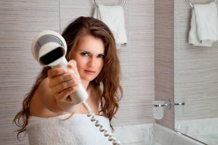 dressed in towel beautiful woman giving you fen at modern bathroom photo