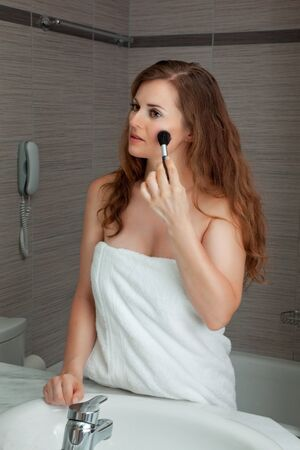 dressed in towel gorgeous woman makeup at modern bathroom Stock Photo - 7635357