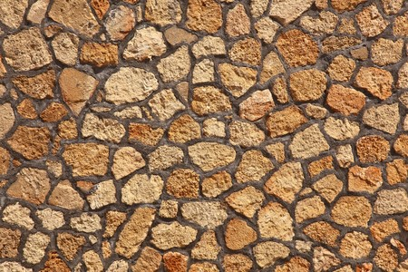 rockwall: high resolution orange rock texture background ideal for backgrounds Stock Photo