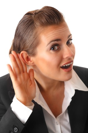 interrogatively: modern business woman holding hand at ear and eavesdrop isolated on white