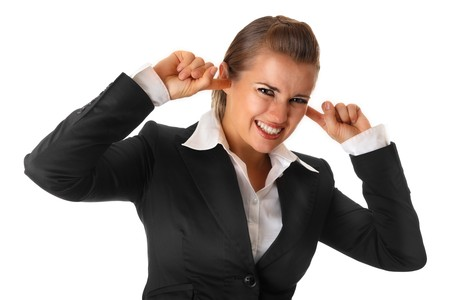 modern business woman closing ears with fingers isolated on white Stock Photo