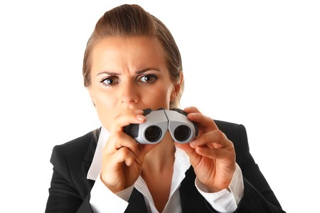 interrogatively: interested modern business woman with  binoculars isolated on white background