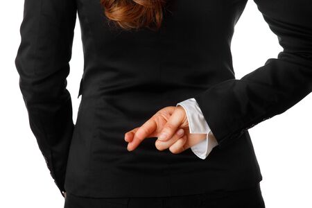 fingers: modern business woman holding crossed fingers behind back isolated on white background