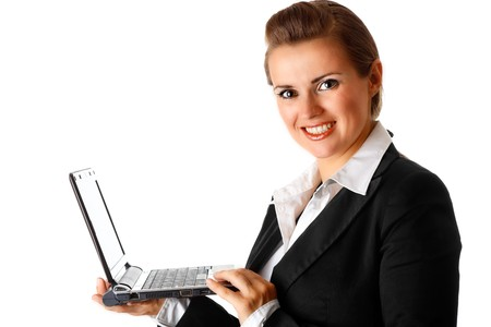 netbook: smiling modern business woman holding laptop in hand isolated on white