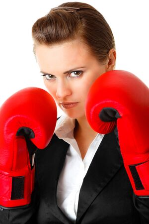 furious modern business woman with boxing gloves isolated on white Stock Photo - 8188689