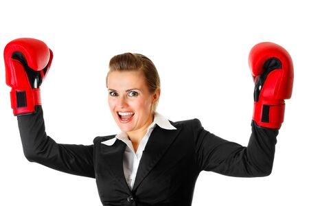 winning modern business woman wearing boxing gloves isolated on white  photo