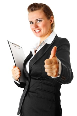 Smiling modern business woman with clipboard  showing thumbs up gesture isolated on white