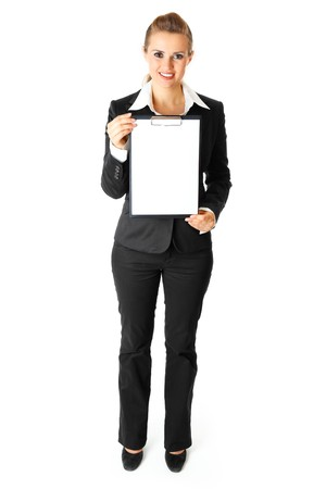 Full length portrait  of friendly modern business woman holding blank clipboard  in hands isolated on white