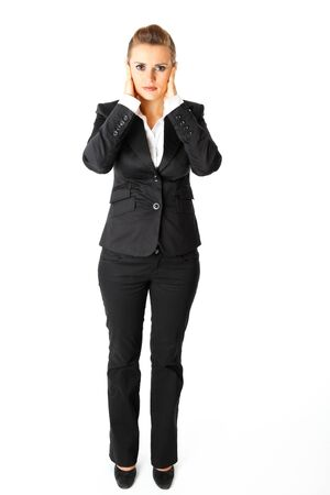Full length portrait of  modern business woman with hand on ears isolated on white