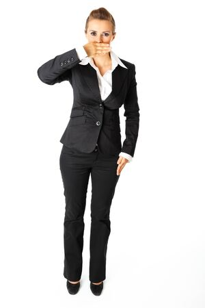 Full length portrait of  modern business woman with hand on mouth isolated on white