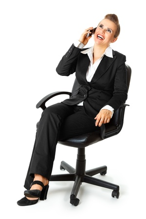 Successful modern business woman sitting on chair and talking on mobile phone  isolated on white Stock Photo - 8274190