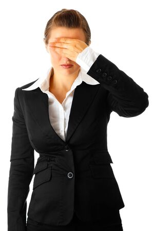 unsuccessfully: Modern business woman with hand on eyes isolated on white