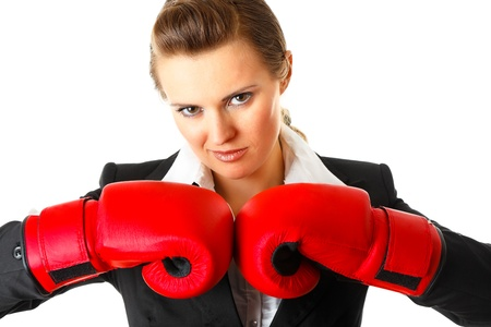 authoritative woman: Confident modern business woman with boxing gloves isolated on white