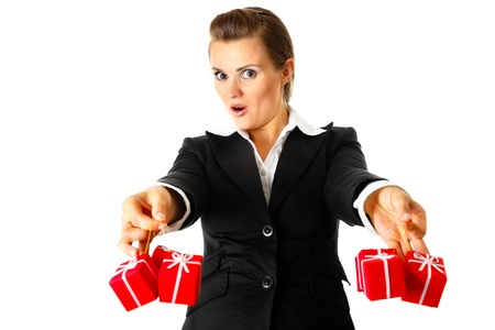 Excited modern business woman holding presents in hands  isolated on white