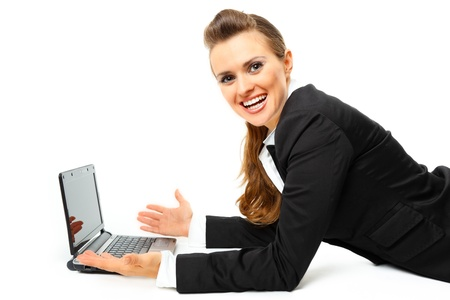 Laying on floor pleased modern business woman using  laptops isolated on white Stock Photo - 8343816