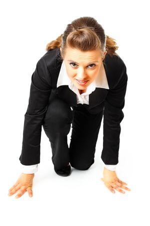 start position: Confident modern business women in start position ready for race isolated on white
