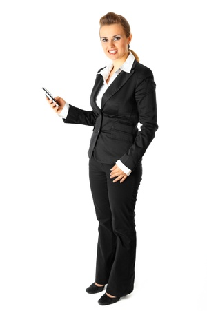 woman dialing phone number:  Full length portrait of smiling modern business woman dialing phone number isolated on white
