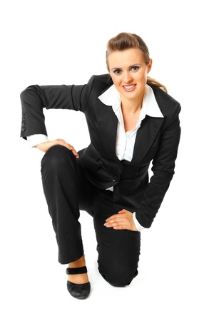 Smiling modern business woman standing on one knee  isolated on white Stock Photo - 8343873