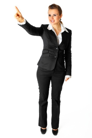 Full length portrait of smiling modern business woman  touching abstract screen isolated on white Stock Photo - 8343863