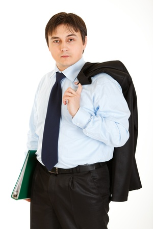 Thoughtful young businessman with jacket on his shoulder holding folder in  hand isolated on white Stock Photo - 8390405