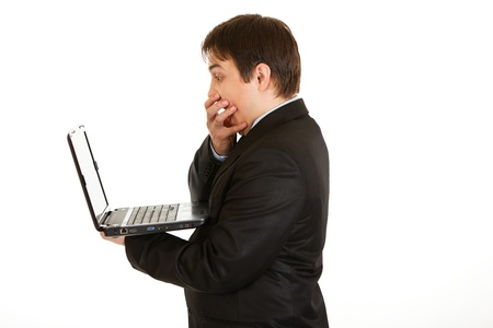 Shocked modern businessman  looking in laptops screen isolated on white Stock Photo - 8390356