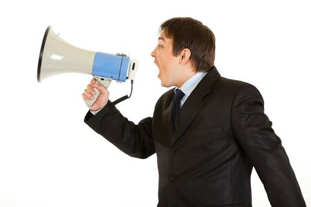 Frustrated young businessman yelling through megaphone isolated on white Stock Photo - 8385906