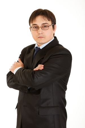 centrality: Serious young businessman with crossed arms on chest and eyeglasses isolated on white