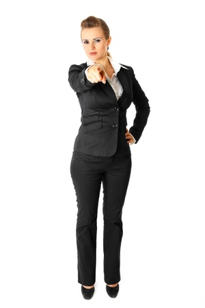 authoritative woman: Full length portrait  of modern business woman pointing finger at you isolated on white  Stock Photo