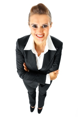 Full length portrait of smiling business woman with crossed arms on chest  isolated on white  photo