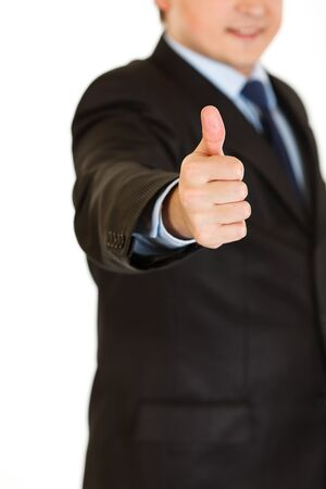 Smiling businessman showing  thumbs up gesture isolated on white.   Close-up.  photo