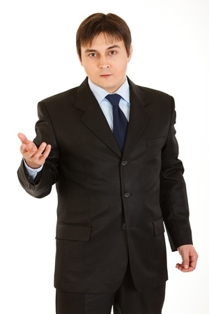 certitude: Confident young  businessman looking at camera isolated on white