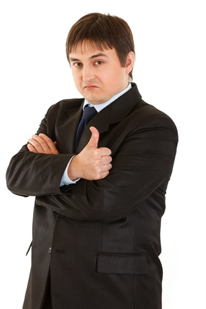 certitude: Confident young businessman showing  thumb up gesture isolated on white. Concept - confidence and reliability  Stock Photo