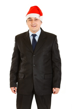 Happy young businessman in Santa hat isolated on white . Happy New Year and Merry Christmas!  photo