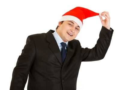 Happy young businessman in hat of Santa Claus isolated on white . Happy New Year and Merry Christmas!  photo