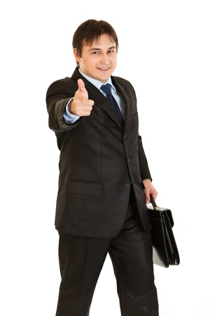 Elegant businessman with briefcase in hand pointing finger at you isolated on white  photo