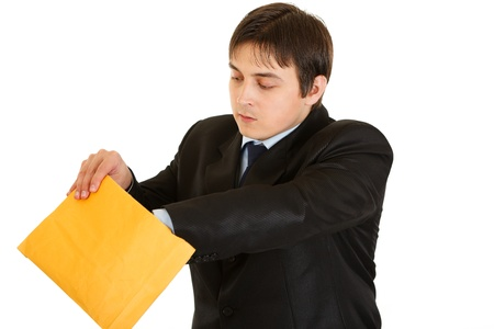 interrogatively: Interested young businessman checking parcel isolated on white