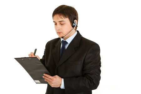 centrality: Serious young businessman with headset and clipboard isolated on white