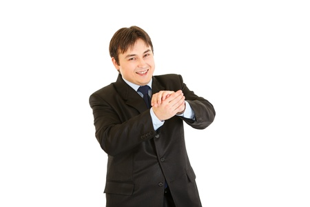cheerfully: Smiling young businessman cheerfully applauding  isolated on white