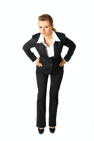 malcontent: Full length portrait of displeased modern business woman  isolated on white