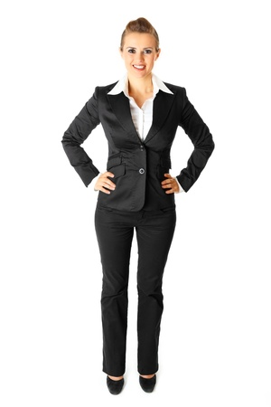Full length portrait of smiling modern business woman with hands on hips Stock Photo - 8624474