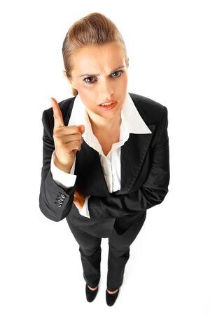 stringent: Full length portrait of strict modern business woman shaking her finger isolated on white