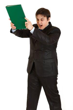 brandishing: Stressed modern businessman brandishing folder with documents isolated on white