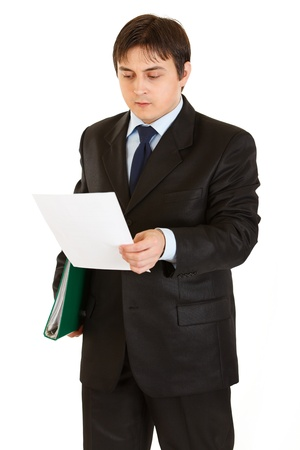 centrality: Serious modern businessman with folder in hand exploring document  isolated on white