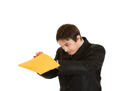 interested: Interested young businessman checking parcel isolated on white