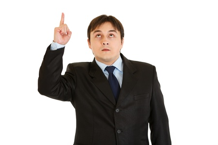 interrogatively: Interested modern businessman pointing finger up isolated on white