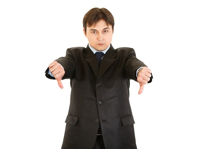 displeased businessman: Displeased modern businessman showing thumbs down gesture isolated on white
